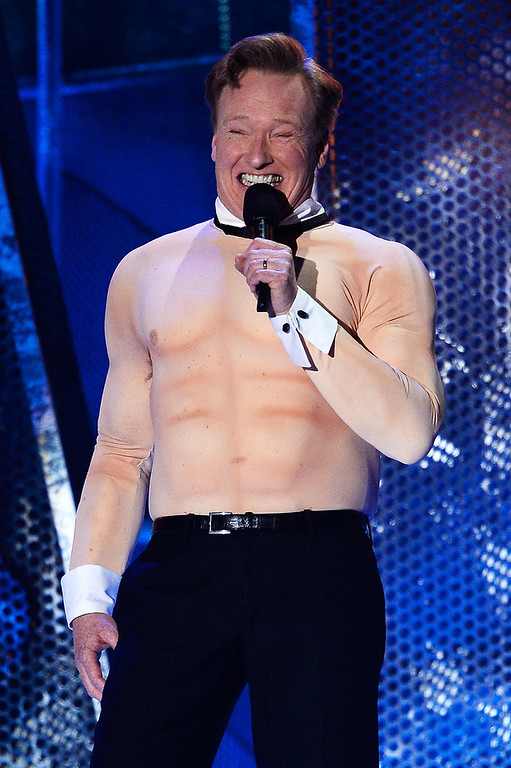 . Host Conan O\'Brien speaks onstage at the 2014 MTV Movie Awards at Nokia Theatre L.A. Live on April 13, 2014 in Los Angeles, California.  (Photo by Kevork Djansezian/Getty Images for MTV)