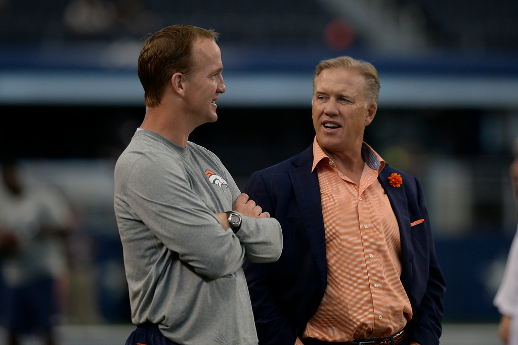 . ARLINGTON, TX - AUGUST 28: Denver Broncos quarterback Peyton Manning talks with Denver Broncos General Manager and Executive Vice President of Football Operations John Elway during the teams warmups before their game against the Dallas Cowboys August 28, 2014 at AT&T Stadium. (Photo by John Leyba/The Denver Post)