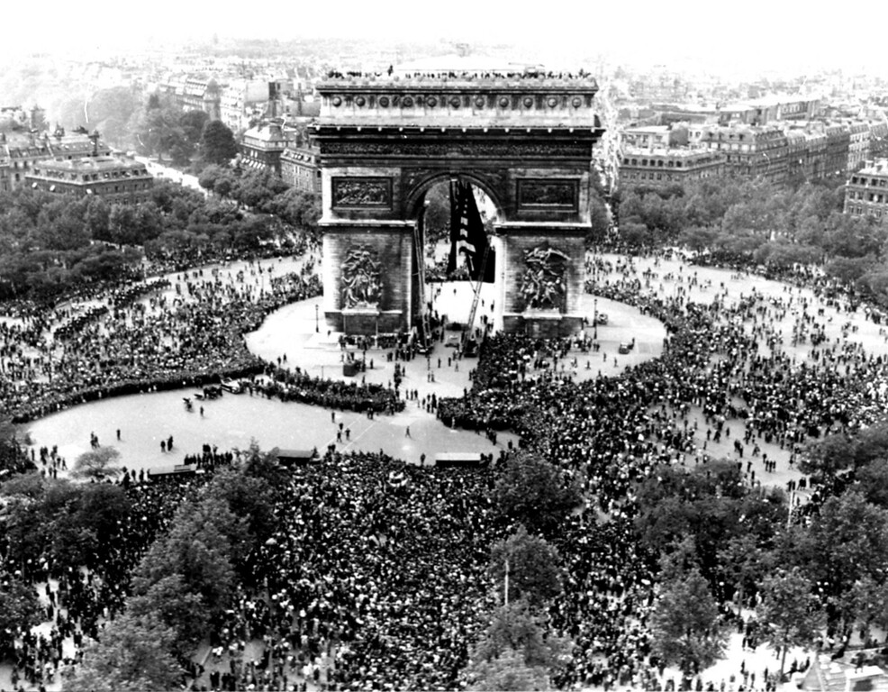 . This is an aerial view of the Arc de Triomphe in Paris on VE Day, May 7, 1945, shows thousands of French people celebrating the announcement of Germany\'s unconditional surrender to the Allies.  British, American and French servicemen mingled with the crowds who sang and danced throughout the night.  (AP Photo/Griffin)