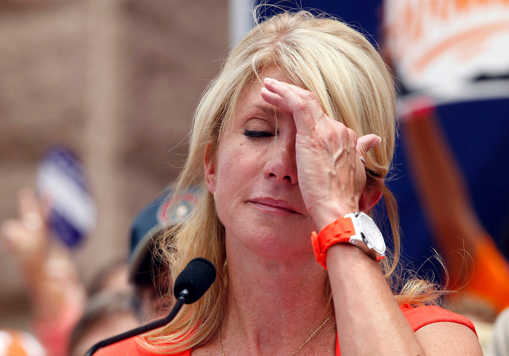. Democratic Senator Wendy Davis wipes her forehead as she speaks during a protest before the start of a special session of the Legislature in Austin, Texas July 1, 2013. When the Texas Legislature convenes on Monday for a second special session, the Republican majority will seek to do what it couldn\'t pull off in the first: Pass sweeping abortion restrictions.  REUTERS/Mike Stone