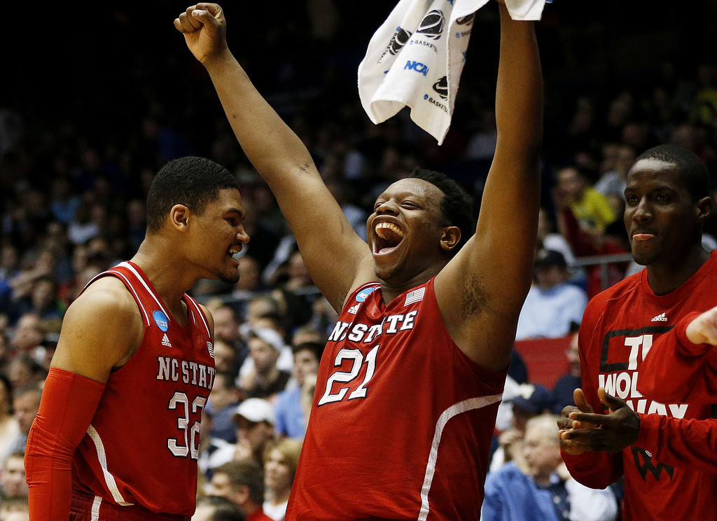 . Beejay Anya #21 celebrates with Kyle Washington #32 of the North Carolina State Wolfpack in the second half against the Xavier Musketeers during the first round of the 2014 NCAA Men\'s Basketball Tournament at at University of Dayton Arena on March 18, 2014 in Dayton, Ohio.  (Photo by Gregory Shamus/Getty Images)