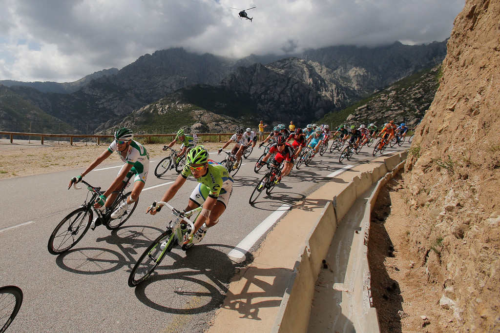 . Peter Sagan of Slovakia, front right, Brice Feillu of France, left, and Cadel Evans of Australia, second row right in red, speed down Vizzavona pass during the second stage of the Tour de France cycling race over 156 kilometers (97.5 miles) with start in Bastia and finish in Ajaccio, Corsica island, France, Sunday June 30, 2013. (AP Photo/Christophe Ena)