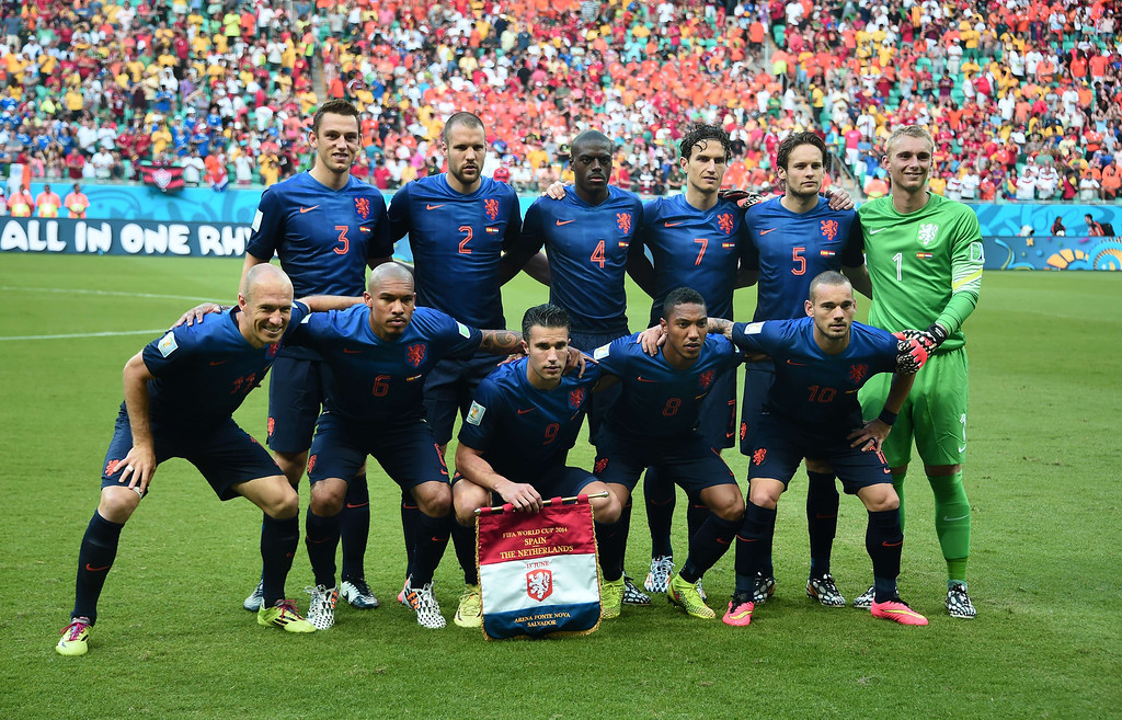 . (top L-R) Netherlands\' defender Stefan de Vrij, Netherlands\' defender Ron Vlaar, Netherlands\' defender Bruno Martins Indi, Netherlands\' defender Daryl Janmaat, Netherlands\' defender Daley Blind, Netherlands\' goalkeeper Jasper Cillessen, (bottom L-R) Netherlands\' forward Arjen Robben, Netherlands\' midfielder Nigel de Jong, Netherlands\' forward Robin van Persie, Netherlands\' midfielder Jonathan de Guzman and Netherlands\' midfielder Wesley Sneijder  line up for a photo before a Group B football match between Spain and the Netherlands at the Fonte Nova Arena in Salvador during the 2014 FIFA World Cup on June 13, 2014.  AFP PHOTO / DAMIEN MEYER/AFP/Getty Images