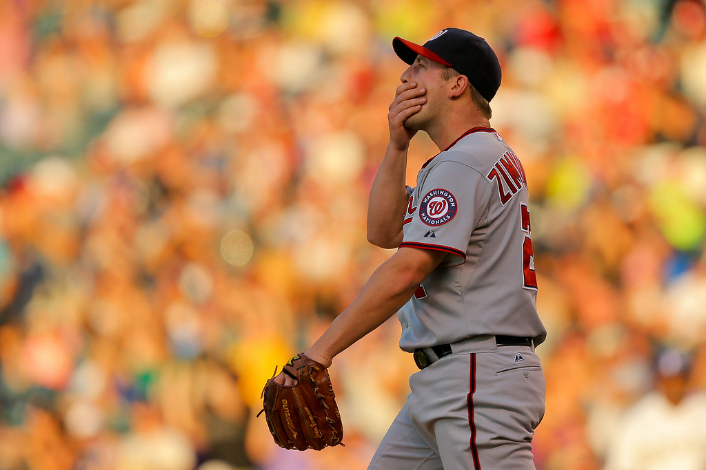 . DENVER, CO - JULY 22:  Starting pitcher Jordan Zimmermann #27 of the Washington Nationals reacts after giving up a two run home run to Nolan Arenado (not pictured) of the Colorado Rockies during the third inning at Coors Field on July 22, 2014 in Denver, Colorado.  (Photo by Justin Edmonds/Getty Images)