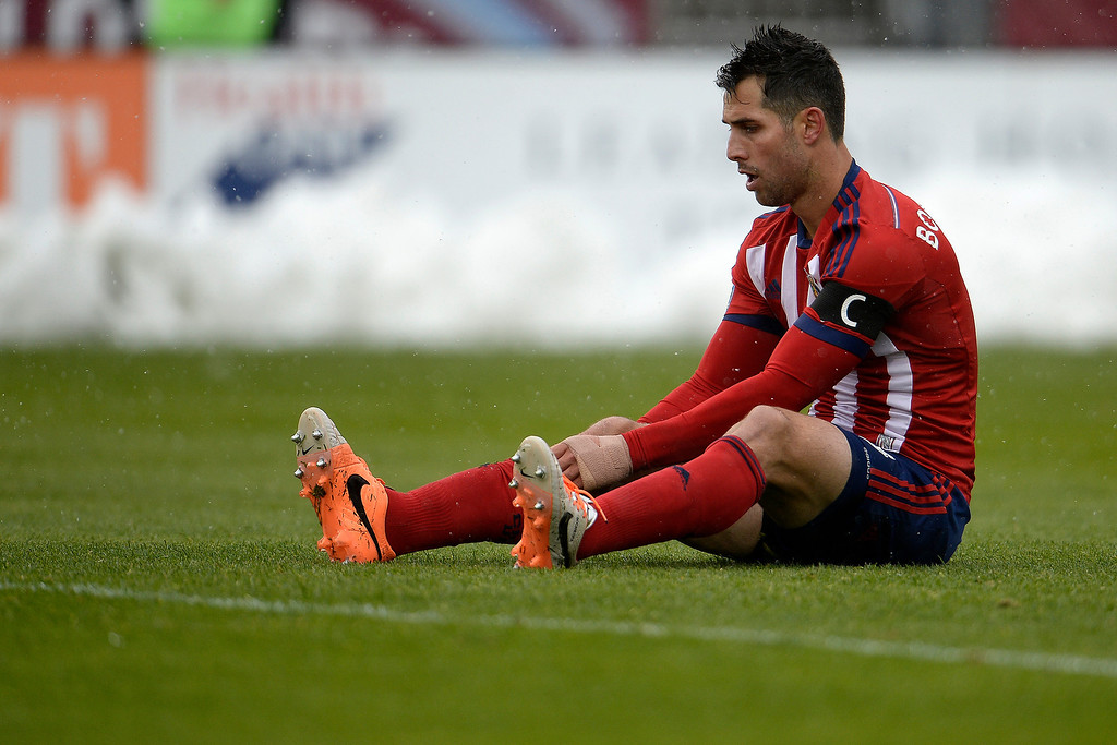 . Carlos Bocanegra (3) of Chivas USA sits on the turf while playing against the Colorado Rapids during the second half. Chivas USA defeated the Colorado Rapids 3-1 on Sunday, May 11, 2014. (Photo by AAron Ontiveroz/The Denver Post)