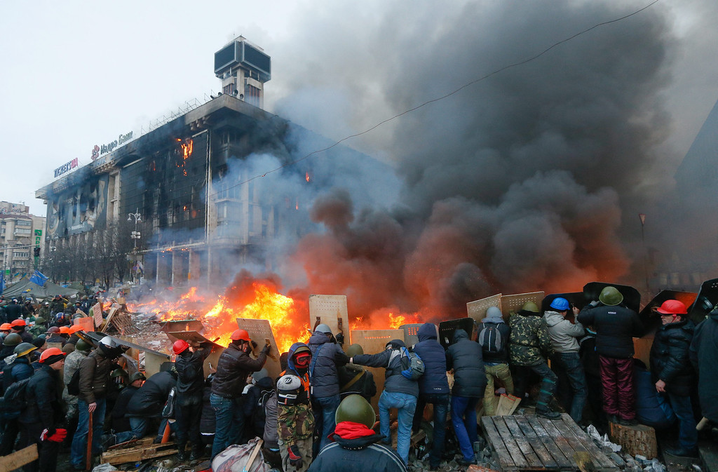 . Protesters hold shields as they clash with riot police during on-going anti-government protests in downtown Kiev, Ukraine, 19 February 2014.   EPA/SERGEY DOLZHENKO