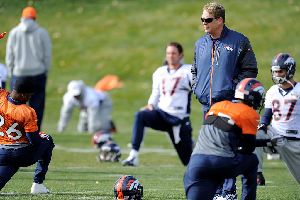 . Denver Broncos defensive coordinator Jack Del Rio walks through the players during practice November 4, 2013 at Dove Valley. The Denver Broncos on Monday named Defensive Coordinator Jack Del Rio as the team�s interim head coach, Executive Vice President of Football Operations John Elway announced.  (Photo by John Leyba/The Denver Post)