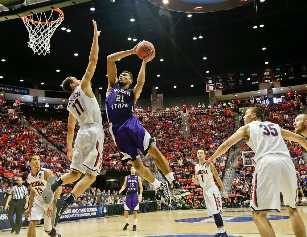 . Weber State\'s Joel Bolomboy (21) tries ot shoot over Arizona forward Aaron Gordon during the second half in a second-round game in the NCAA college basketball tournament Friday, March 21, 2014, in San Diego. (AP Photo/Gregory Bull)