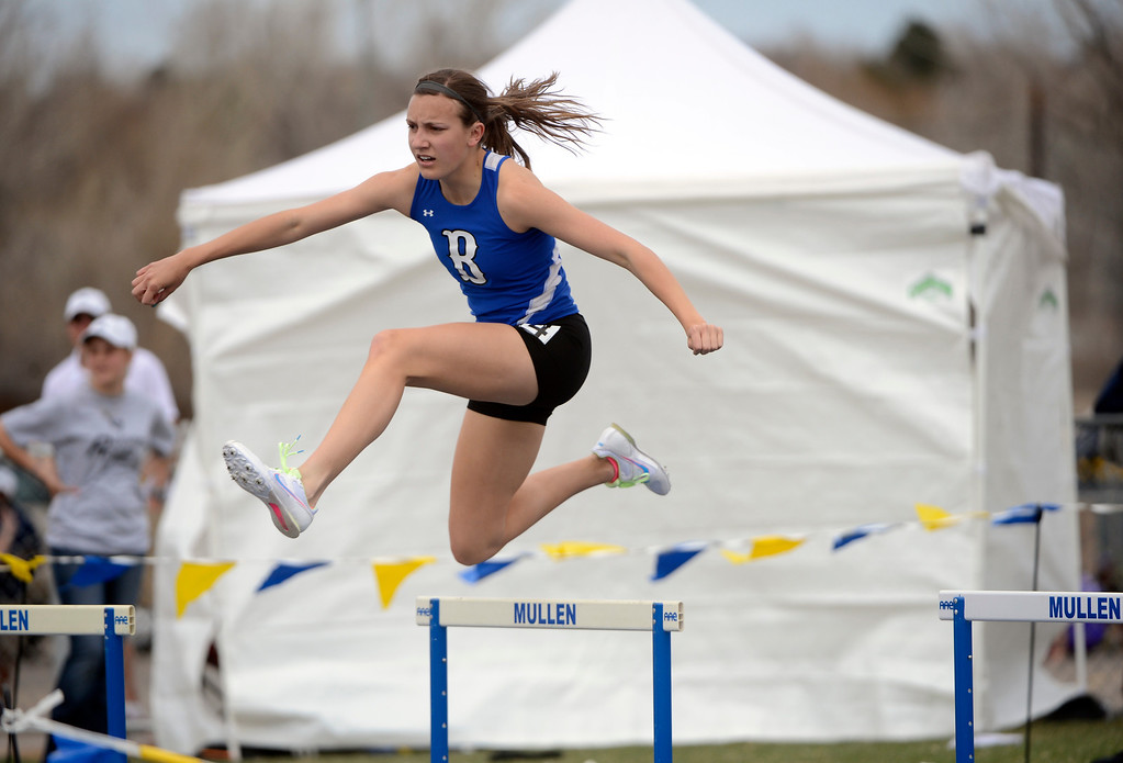 . DENVER, CO. - APRIL 13TH: Katie Croell, Broomfield High School, jumps a hurdle during the girls 300 meter hurdles at the Mullen Runners Roost 2013 Track and Field Invitational at Mullen High School, Saturday April, 13th 2013.(Photo By Andy Cross/The Denver Post)