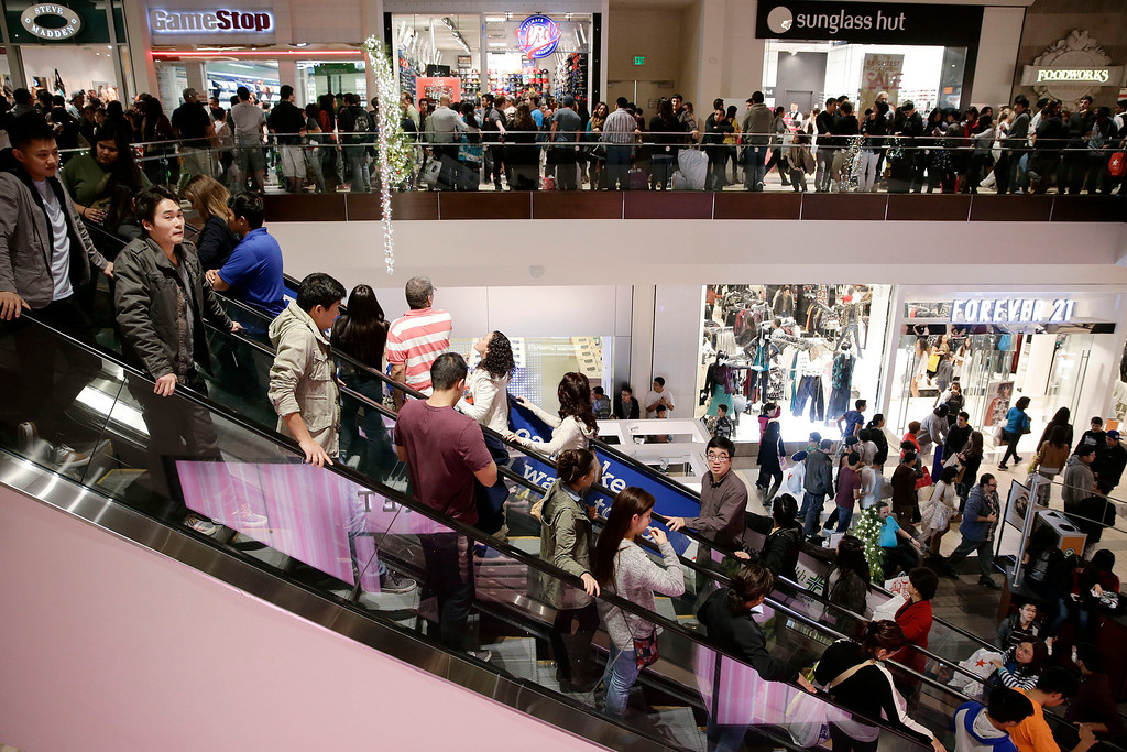 . Shoppers throng Brea Mall during Black Friday shopping on Friday, Nov. 29, 2013, in Brea, Calif. The U.S. holiday shopping season started even earlier this year, as more than a dozen major retailers opened on the Thanksgiving holiday. (AP Photo/Jae C. Hong)