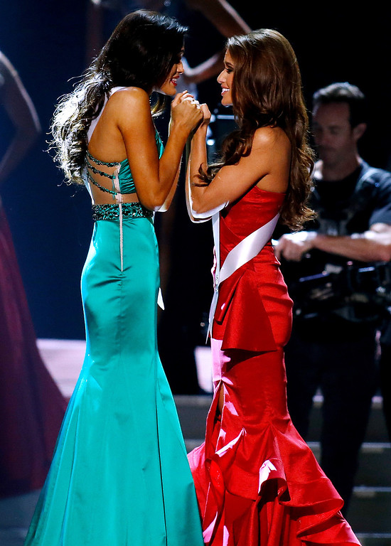 . Miss North Dakota USA Audra Mari, left, and Miss Nevada USA Nia Sanchez await the final decision during the Miss USA 2014 pageant in Baton Rouge, La., Sunday, June 8, 2014. Sanchez would go on to win the Miss USA 2014 title. (AP Photo/Jonathan Bachman)