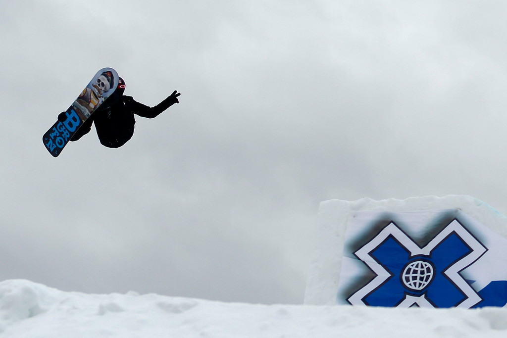 . ASPEN, CO. - JANUARY 24: Shaun White hits a jump during the men\'s Snowboard Slopestyle elimination. Men\'s Snowboard Slopestyle elimination X Games Aspen Buttermilk Mountain Aspen January 24, 2013. (Photo By AAron Ontiveroz / The Denver Post)