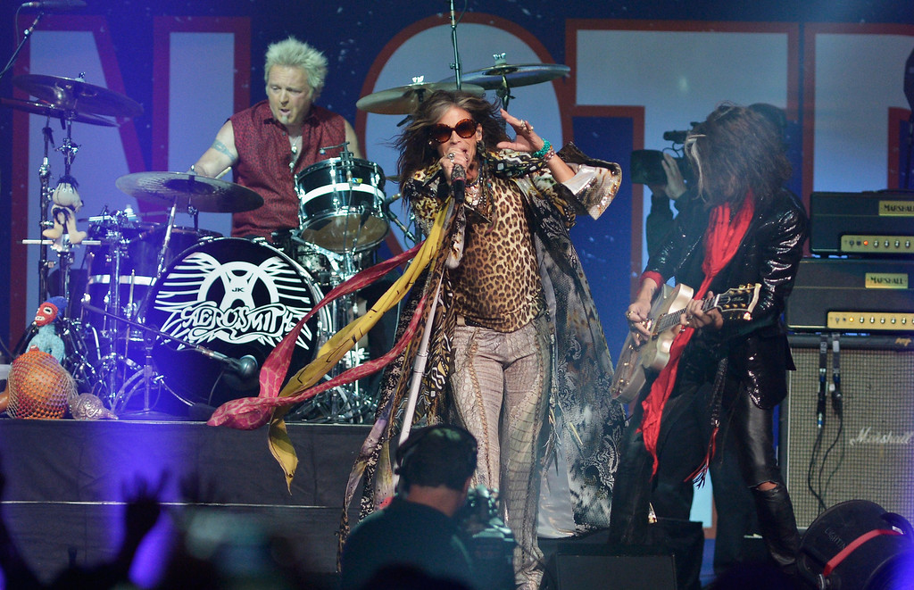 . Steven Tyler and Aerosmith perform during the Boston Strong: An Evening Of Support And Celebration>> at TD Garden on May 30, 2013 in Boston, Massachusetts.  (Photo by Paul Marotta/Getty Images)