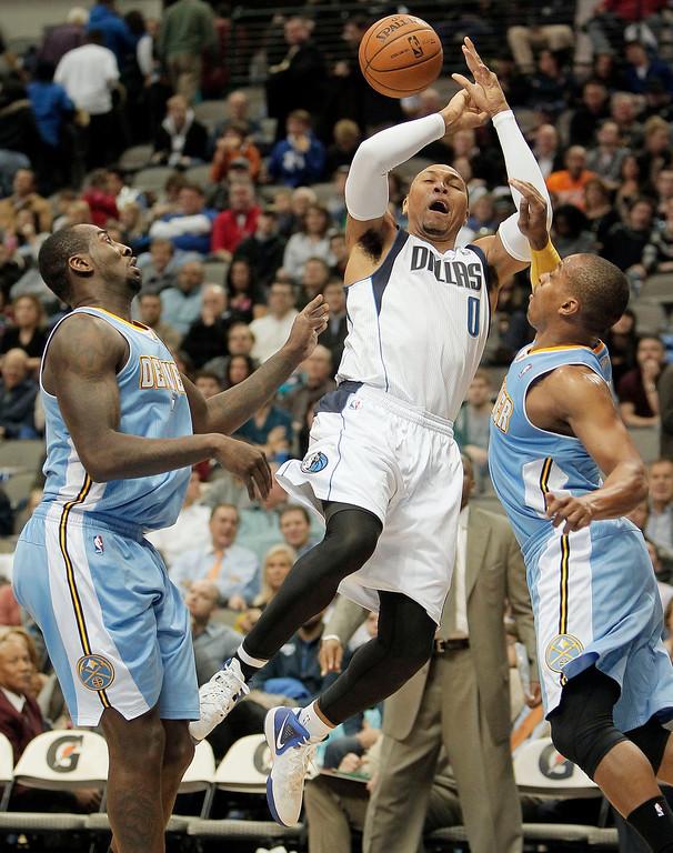 . Dallas Mavericks forward Shawn Marion (0) loses control of the ball as Denver Nuggets\' J.J. Hickson (7) and Randy Foye (4) defend during the second half of an NBA basketball game Monday, Nov. 25, 2013, in Dallas. Denver won 110-96. (AP Photo/Brandon Wade)