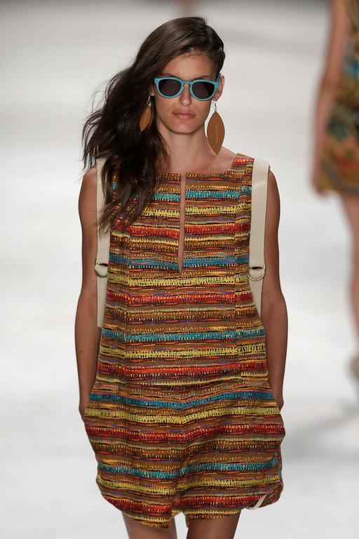 . A model wears a creation from the Cantao collection during Fashion Week in Rio de Janeiro, Brazil, Thursday, April 10, 2014. (AP Photo/Felipe Dana)