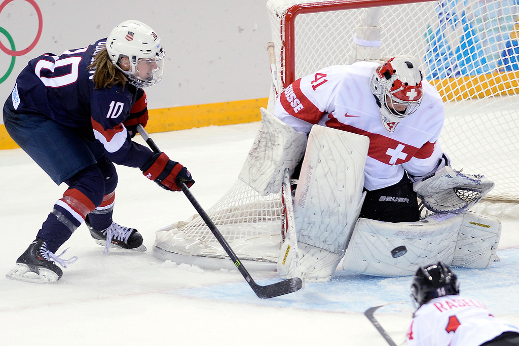 . Meghan Duggan (10) of the U.S.A. takes a shot on Florence Schelling (41) of the Switzerland during the third period of the United States\' 9-0 win at the Shayba Arena. Sochi 2014 Winter Olympics on Monday, February 10, 2014. (Photo by AAron Ontiveroz/The Denver Post)
