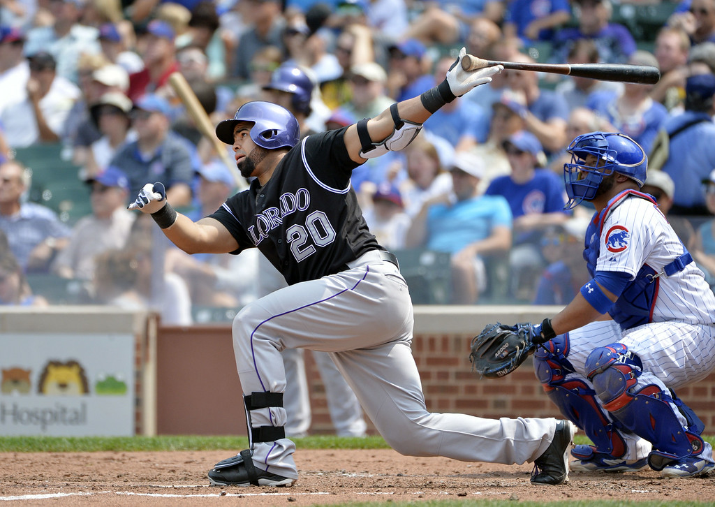 . Wilin Rosario #20 of the Colorado Rockies hits a single during the fifth inning to break up a perfect game being thrown by starting pitcher Jake Arrieta #49 of the Chicago Cubs at Wrigley Field on July 31, 2014 in Chicago, Illinois.  (Photo by Brian Kersey/Getty Images)