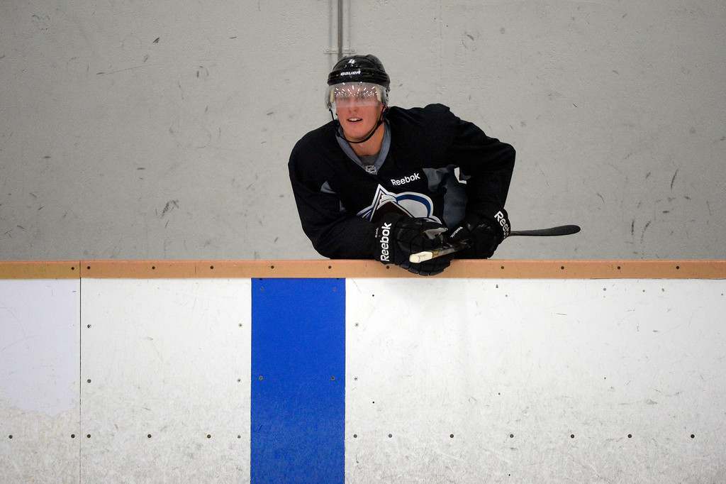 . Colorado Avalanche Tyson Barrie (4) looks on from the bench during practice September 10, 2013 at Family Sports.  (Photo By John Leyba/The Denver Post)