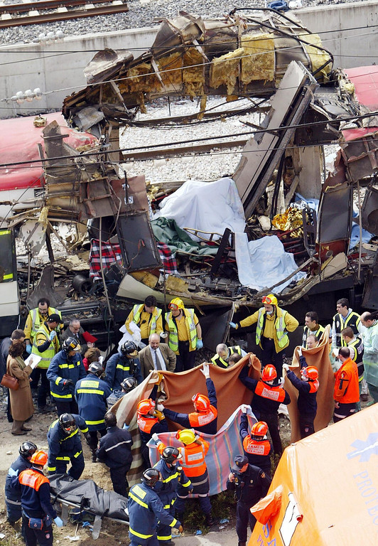 . Bodies of victims are evacuated after a train exploded near the Atocha train station in Madrid 11 March 2004. At least 131 people were killed and some 400 injured early 11 March 2004 in near-simultaneous explosions on three trains in Madrid at the height of morning commuter traffic, the Spanish interior ministry said. In what appeared to be a deliberate attack staged only 72 hours ahead of Spanish general elections, the blasts went off on a long-distance high-speed carrier and two suburban trains packed with commuters. CHRISTOPHE SIMON/AFP/Getty Images