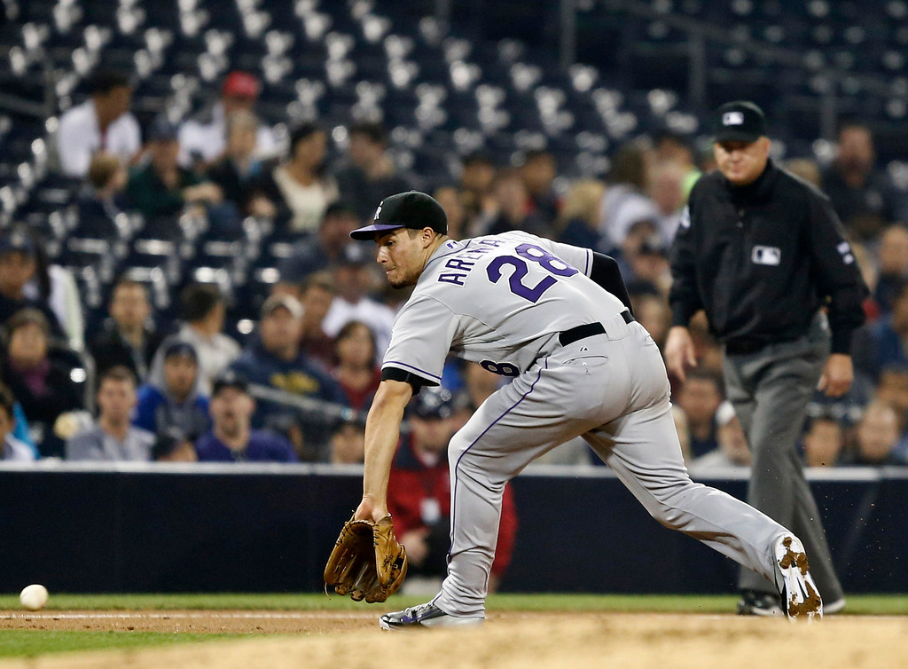 . Colorado Rockies third baseman Nolan Arenado makes the backhand grab to start a double play on a grounder down the line hit by San Diego Padres\' Chris Denorfia in the third inning of a baseball game Wednesday, April 16, 2014, in San Diego. (AP Photo/Lenny Ignelzi)