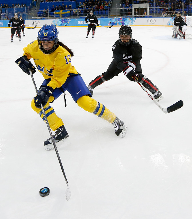 . Lina Wester of Sweden takes control of the puck from Ayaka Toko of Japan during the 2014 Winter Olympics women\'s ice hockey game at Shayba Arena, Sunday, Feb. 9, 2014, in Sochi, Russia. (AP Photo/Petr David Josek)