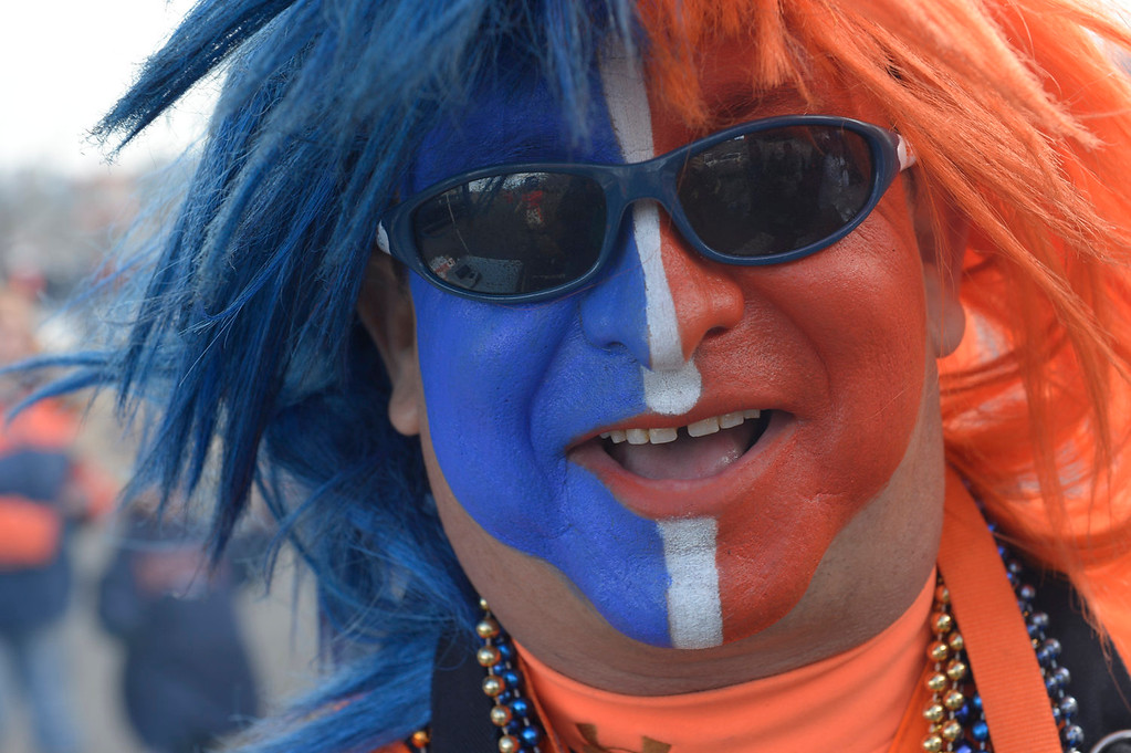 . Ken Castaneda shows off his face paint before the start of the game. The Denver Broncos take on the San Diego Chargers at Sports Authority Field at Mile High in Denver on January 12, 2014. (Photo by Craig F. Walker/The Denver Post)