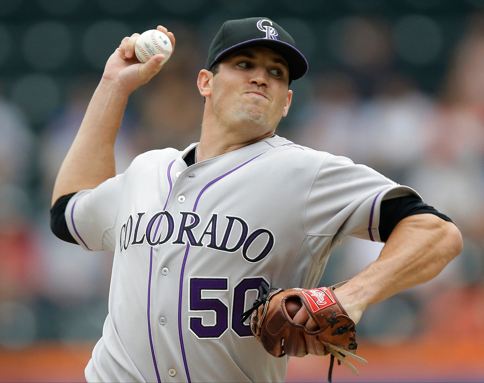 . Colorado Rockies starting pitcher Jeff Manship delivers against the New York Mets in the first inning of a baseball game in New York, Thursday, Aug. 8, 2013. (AP Photo/Kathy Willens)