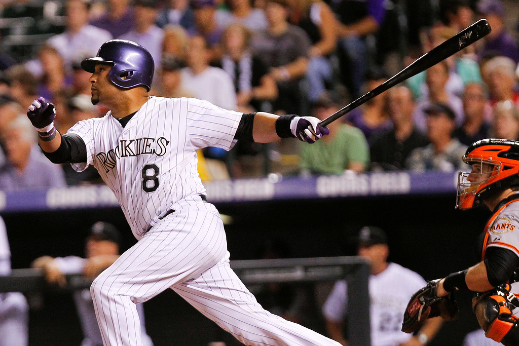 . Colorado Rockies Yorvit Torrealba hits a ground rule double scoring two runs during the sixth inning of a baseball game, Wednesday, Aug. 28, 2013, in Denver. (AP Photo/Barry Gutierrez)