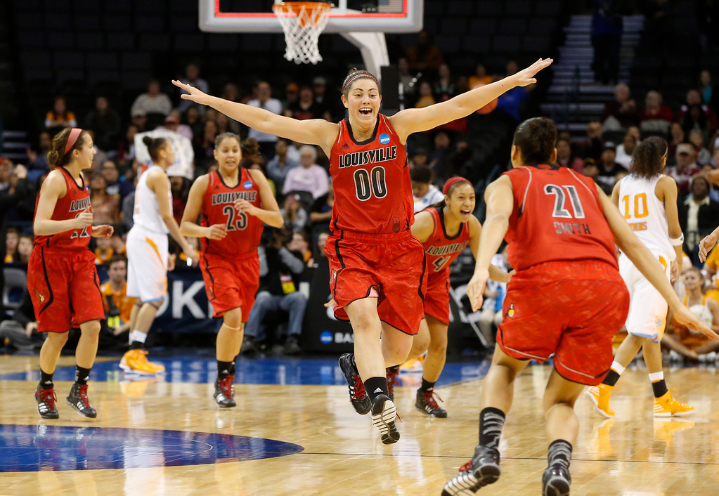 . Louisville guard Jude Schimmel (22), guard Shoni Schimmel (23), forward Sara Hammond (00), guard Antonita Slaughter (4) and guard Bria Smith (21) celebrate the team\'s 86-78 victory over Tennessee in the regional final in the NCAA women\'s college basketball tournament in Oklahoma City, Tuesday, April 2, 2013. (AP Photo/Sue Ogrocki)