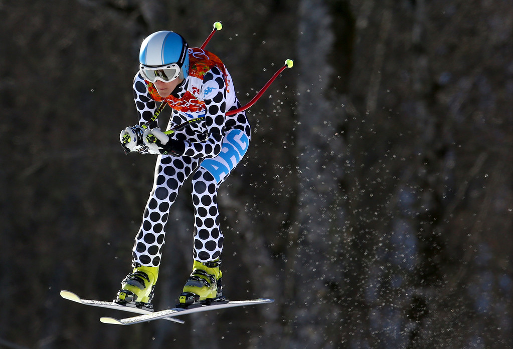 . Argentina\'s Macarena Simari Birkner makes a jump during the women\'s downhill at the Sochi 2014 Winter Olympics, Wednesday, Feb. 12, 2014, in Krasnaya Polyana, Russia. (AP Photo/Alessandro Trovati)