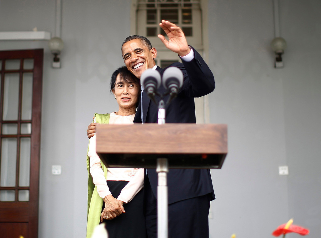 . U.S. President Barack Obama (R) hugs Aung San Suu Kyi at the end of their remarks to the media at her residence in Yangon, November 19, 2012. President Obama became the first serving U.S. president to visit Myanmar on Monday, trying during a whirlwind six-hour trip to strike a balance between praising the government\'s progress in shaking off military rule and pressing for more reform.  REUTERS/Jason Reed