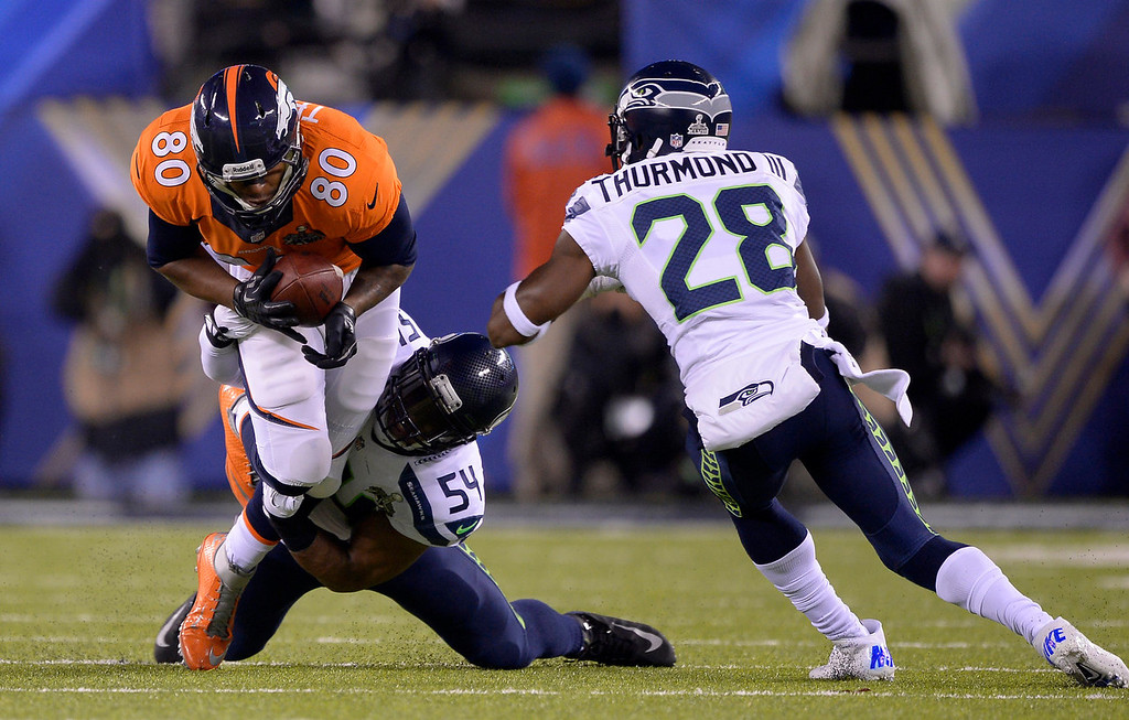 . Denver Broncos tight end Julius Thomas (80) gets taken down by Seattle Seahawks middle linebacker Bobby Wagner (54) during the first quarter. The Denver Broncos vs the Seattle Seahawks in Super Bowl XLVIII at MetLife Stadium in East Rutherford, New Jersey Sunday, February 2, 2014. (Photo by John Leyba/The Denver Post)
