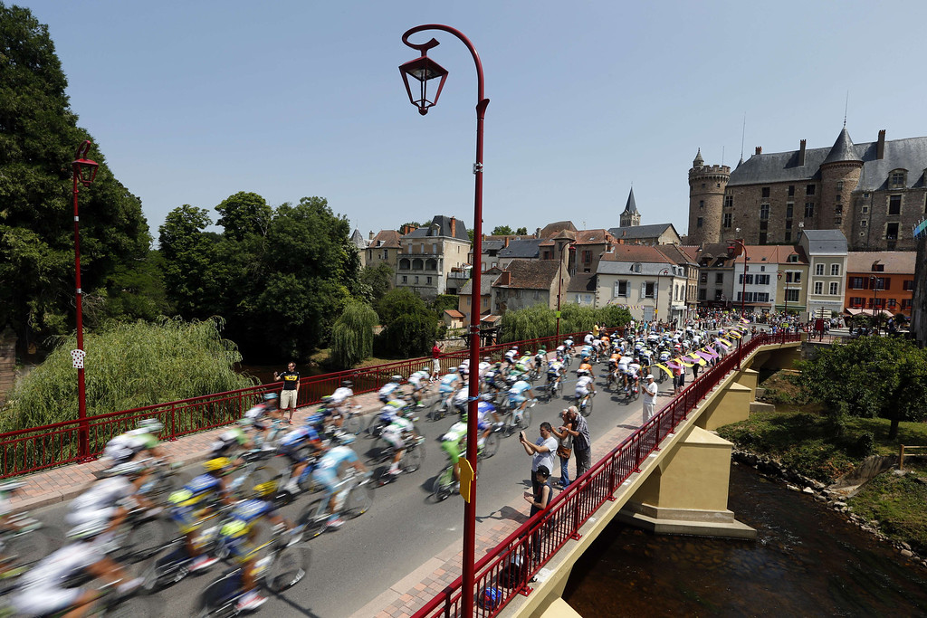 . The pack rides on a bridge during the 191 km fourteenth stage of the 100th edition of the Tour de France cycling race on July 13, 2013 between Saint-Pourcain-sur-Sioule and Lyon, central eastern France. JOEL SAGET/AFP/Getty Images