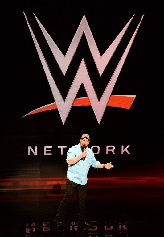 ". Actor and WWE personality ""Stone Cold\"" Steve Austin speaks at a news conference announcing the WWE Network at the 2014 International CES at the Encore Theater at Wynn Las Vegas on January 8, 2014 in Las Vegas, Nevada. The network will launch on February 24, 2014 as the first-ever 24/7 streaming network, offering both scheduled programs and video on demand. The USD 9.99 per month subscription will include access to all 12 live WWE pay-per-view events each year. CES, the world\'s largest annual consumer technology trade show, runs through January 10 and is expected to feature 3,200 exhibitors showing off their latest products and services to about 150,000 attendees.  (Photo by Ethan Miller/Getty Images)"