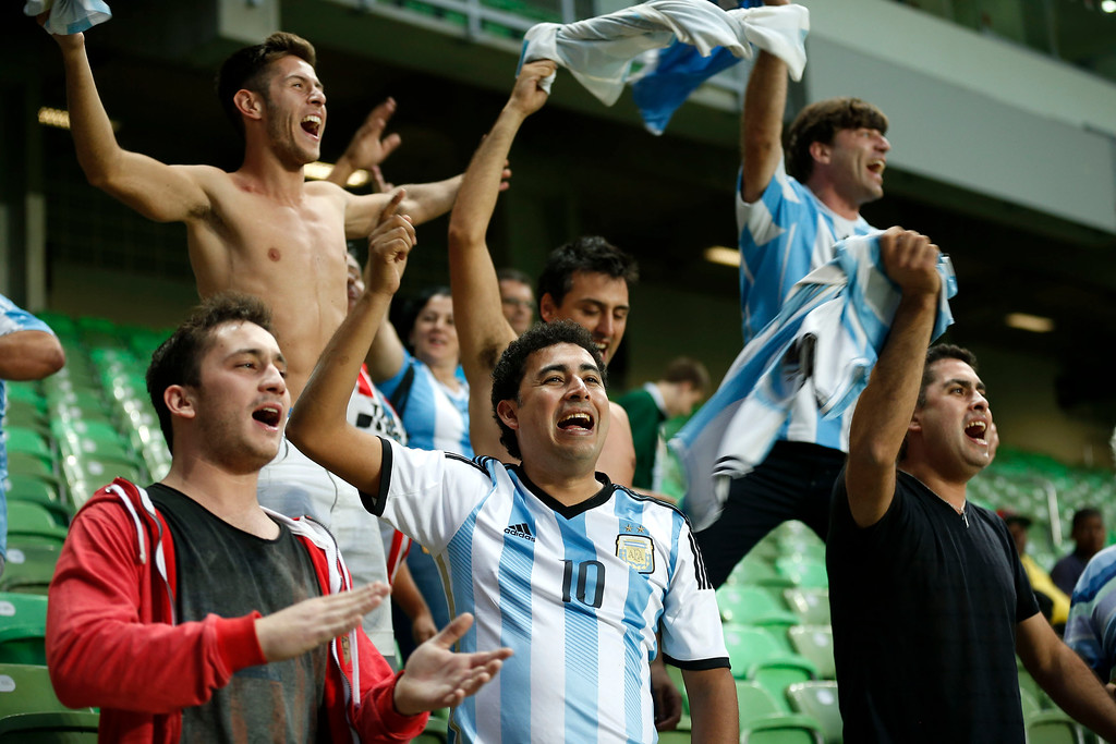 . Argentine fans cheer for their team before the start of a training session at Independencia Stadium in Belo Horizonte, Brazil, Wednesday, June 11, 2014. Argentina will play in group F of the Brazil 2014 soccer World Cup. (AP Photo/Victor R. Caivano)