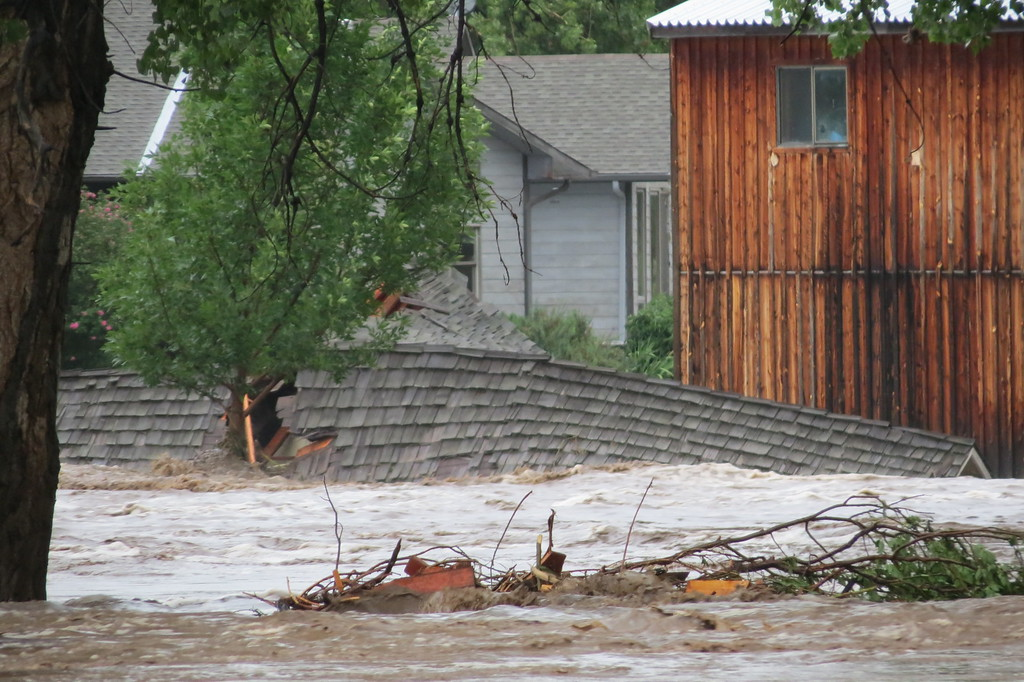 . The enormous rage from the canyon current is seen from Mariana Butte as the Big Thompson River took down structures in it\'s path, flooding Loveland, Colorado on Friday, September 13th. Photo by Mike Garcia