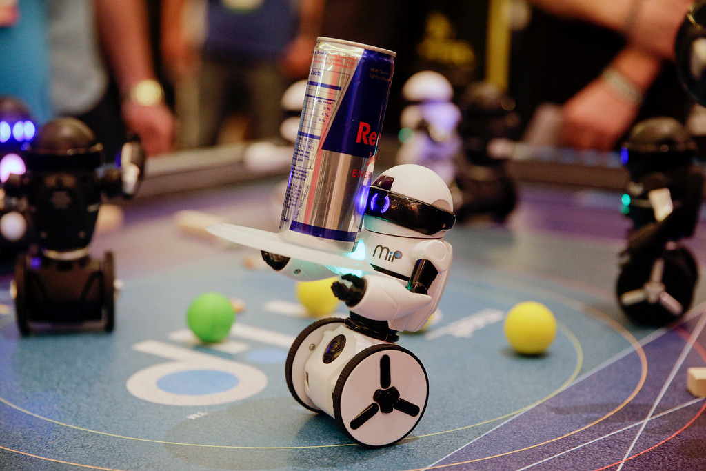 . WowWee\'s MiP, a balancing robot that can be controlled by hand motions or smartphones, carries a can of energy drink at the International Consumer Electronics Show on Wednesday, Jan. 8, 2014, in Las Vegas. (AP Photo/Jae C. Hong)