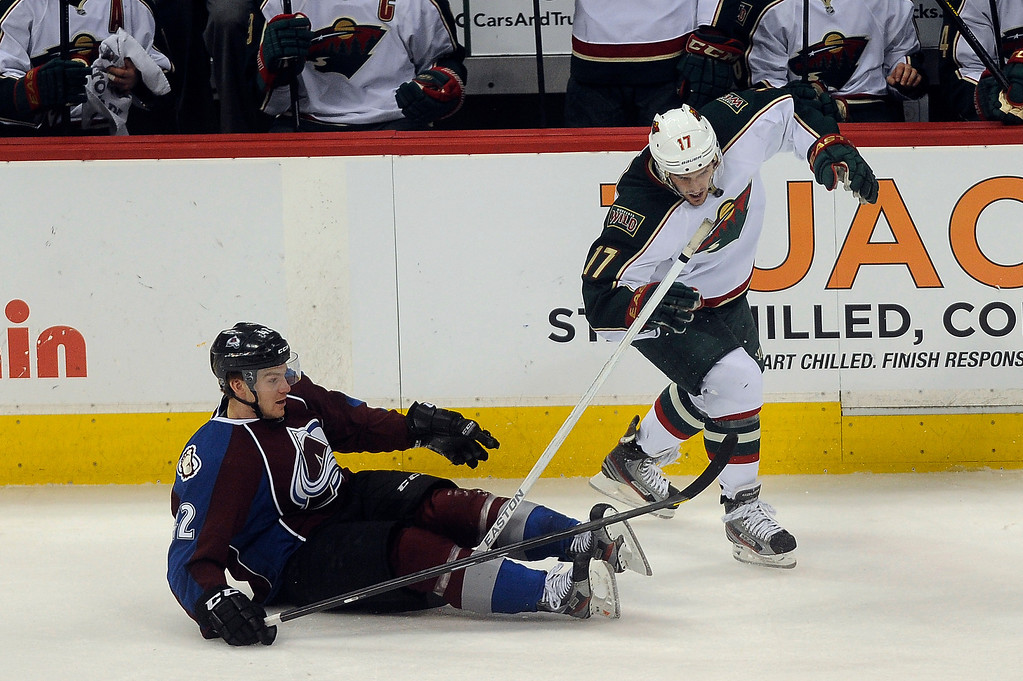 . Gabriel Landeskog (92) of the Colorado Avalanche knocks the stick from the hands of Torrey Mitchell (17) of the Minnesota Wild after falling to the ice during the second period, Saturday, April 27, 2012 at Pepsi Center. Seth A. McConnell, The Denver Post