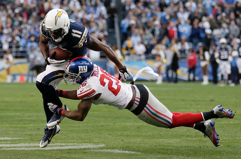 . San Diego Chargers wide receiver Eddie Royal, left, gets past New York Giants strong safety Antrel Rolle, right, in the second half of an NFL football game on Sunday, Dec. 8, 2013, in San Diego. (AP Photo/Gregory Bull)
