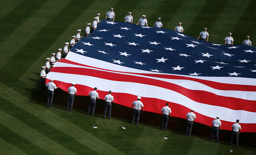. A giant American flag is unfurled by cadets from the U.S. military academy at West Point in center field at the Yankee Stadium before the opening day MLB American League baseball game between the New York Yankees and the Boston Red Sox in New York, April 1, 2013.  REUTERS/Mike Segar