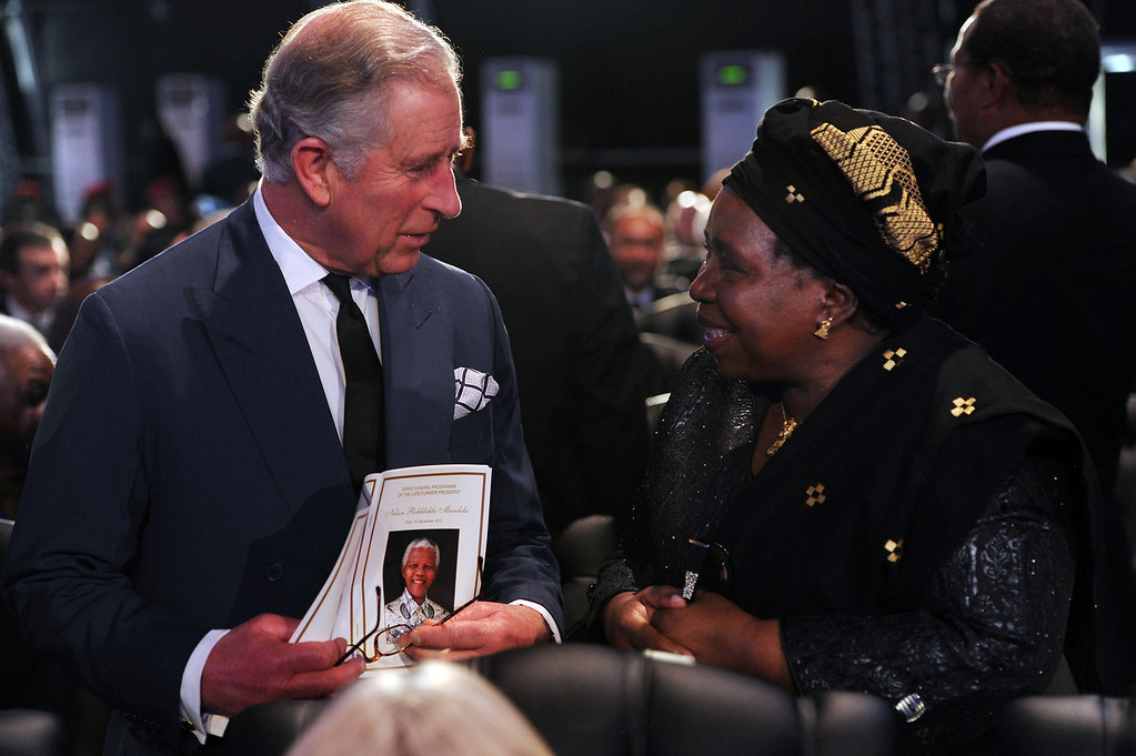 . Britain\'s Prince Charles speaks with Nkosazana Dlamini-Zuma before the funeral service for former South African President Nelson Mandela in Qunu, South Africa, Sunday, Dec. 15, 2013. (AP Photo/Felix Dlangamandla, Pool)
