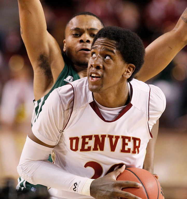 . Denver forward Royce O\'Neale, front, goes up for a shot past Ohio guard D.J. Cooper in the first half of a first-round NIT college basketball game basketball in Denver on Tuesday, March 19, 2013. (AP Photo/David Zalubowski)