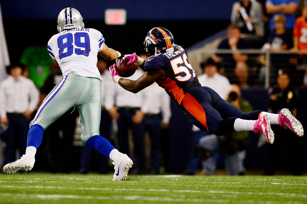 . Danny Trevathan (59) of the Denver Broncos intercepts a ball intended for Gavin Escobar (89) of the Dallas Cowboys during the second half of the Broncos\' 51-48 win at AT&T Stadium. The interception set up a game-winning field goal by Matt Prater (5) of the Denver Broncos. (Photo by AAron Ontiveroz/The Denver Post)