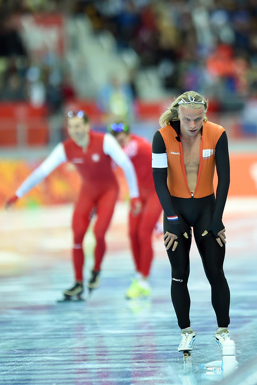 . Netherlands\' Koen Verweij (R) reacts next to Poland\'s Zbigniew Brodka after the Men\'s Speed Skating 1500 m at the Adler Arena during the Sochi Winter Olympics on February 15, 2014.  JUNG YEON-JE/AFP/Getty Images