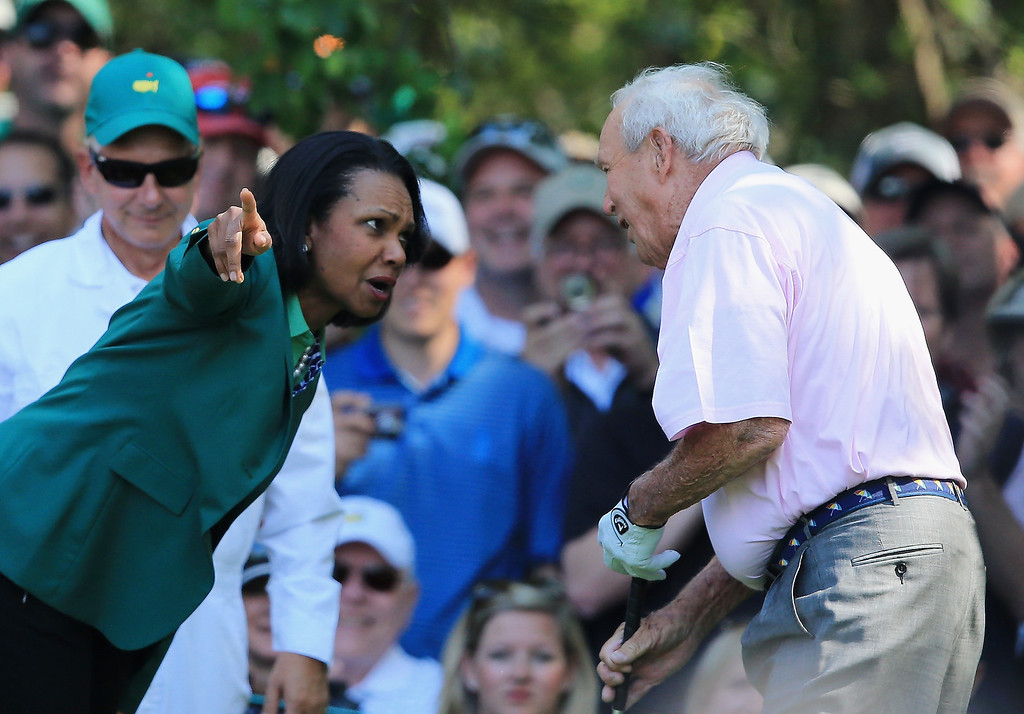 . Condoleezza Rice, former Secretary of State and current Augusta National Member, greets Arnold Palmer at the 2014 Par 3 Contest prior to the start of the 2014 Masters Tournament at Augusta National Golf Club on April 9, 2014 in Augusta, Georgia.  (Photo by David Cannon/Getty Images)