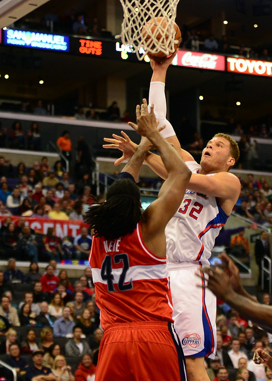 . Blake Griffin of the Los Angeles Clippers shoots under pressure from Nene of the Washington Wizards (#42) during their NBA game in Los Angeles on January 19, 2013.  FREDERIC J. BROWN/AFP/Getty Images
