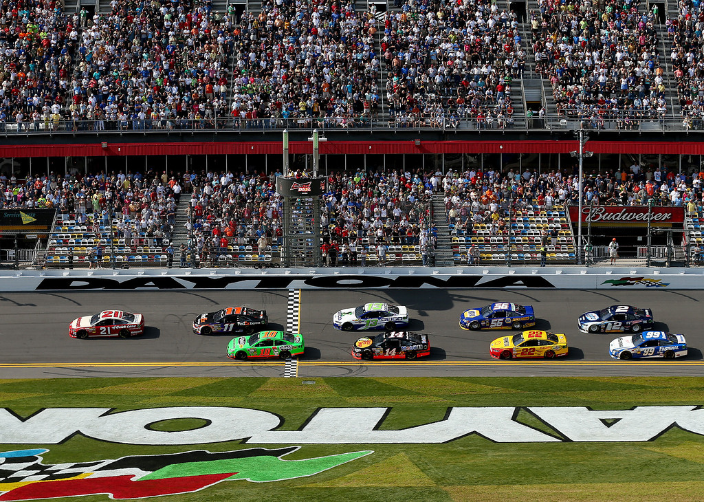 . Trevor Bayne, driver of the #21 Motorcraft/Quick Lane Tire & Auto Center Ford, leads the field during the NASCAR Sprint Cup Series Budweiser Duel 1 at Daytona International Speedway on February 21, 2013 in Daytona Beach, Florida.  (Photo by Mike Ehrmann/Getty Images)