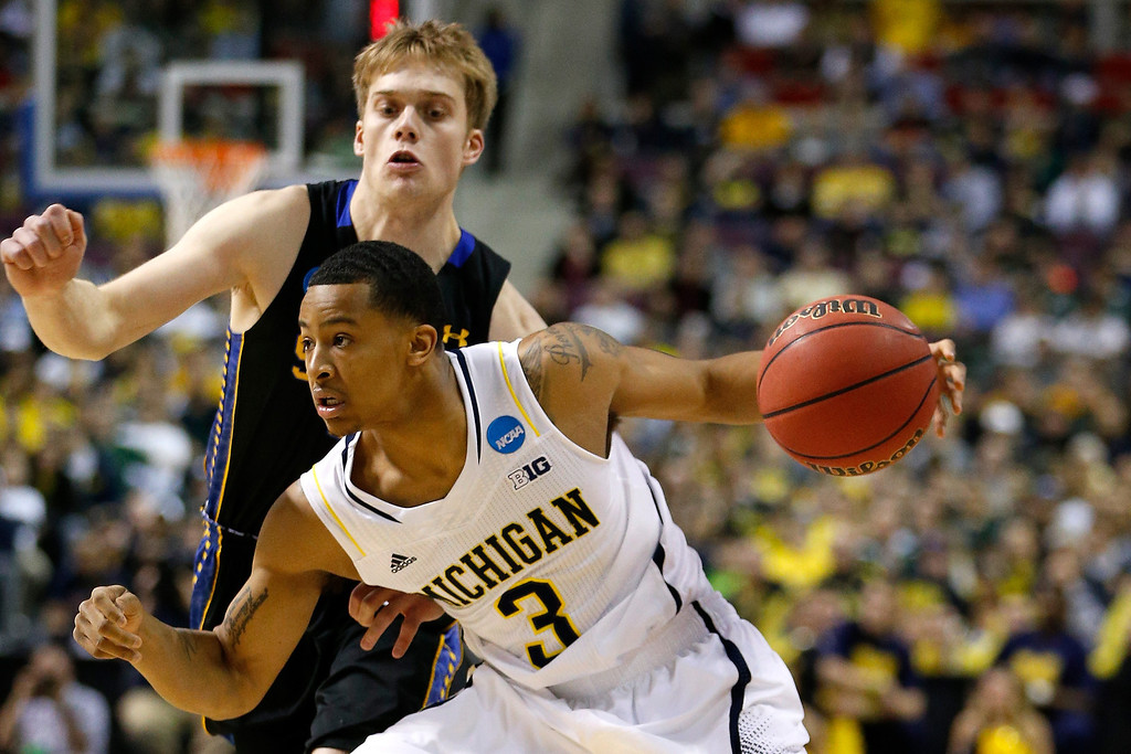 . Trey Burke #3 of the Michigan Wolverines drives in the first half against South Dakota State Jackrabbits during the second round of the 2013 NCAA Men\'s Basketball Tournament at at The Palace of Auburn Hills on March 21, 2013 in Auburn Hills, Michigan.  (Photo by Gregory Shamus/Getty Images)
