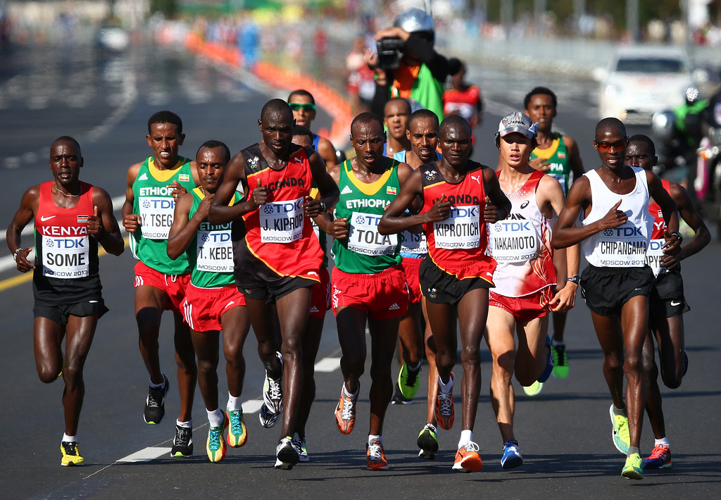 . MOSCOW, RUSSIA - AUGUST 17:  (L-R) Jackson Kiprop of Uganda, Tadese Tola of Ethiopia and Stephen Kiprotich of Uganda lead the pack in the Men\'s Marathon during Day Eight of the 14th IAAF World Athletics Championships Moscow 2013 at Luzhniki Stadium on August 17, 2013 in Moscow, Russia.  (Photo by Paul Gilham/Getty Images)