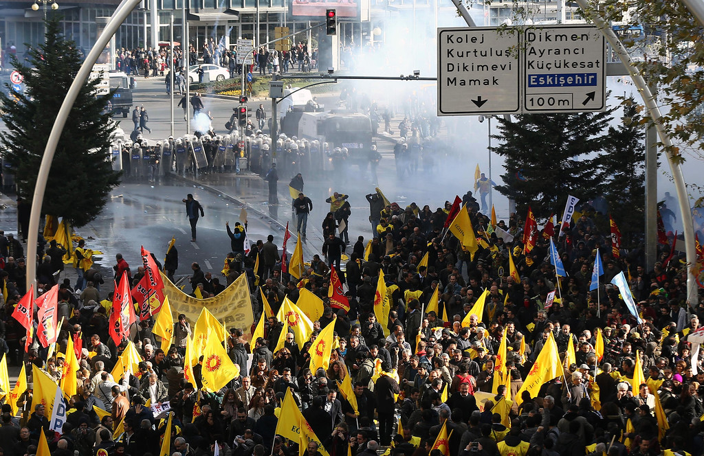 . Riot police use water cannons and pepper gas to disperse thousands of Turkish teachers who were gathered to protest against the government\'s education and economic policies in Ankara, Turkey, Saturday, Nov. 23, 2013.(AP Photo/Burhan Ozbilici)